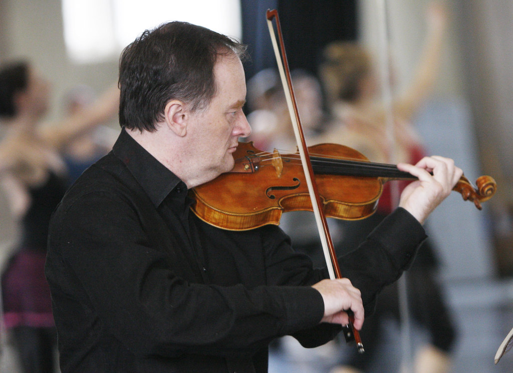 February 14, 2010 - Krzysztof Gadawski plays the violin for the dancers at a rehearsal in Smith Studio at Smith College in Northampton.