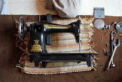 The Sewing Machine Whisperer (mynameisharsha) Tags: old india thread metal fix screw hands nikon antique sewing parts bangalore machine gear sew grandpa age repair bolt oil nut craftsman wrinkles merritt screwdriver intricate d60 worksmanship 1855mmf3556gvr mynameisharsha