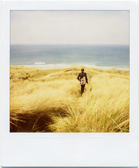 . (Rebecca...) Tags: uk sea summer grass polaroid sx70 spring cornwall surf waves surfer dunes april 779filmwithblendfilter sx7020004w
