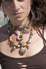 Playful Necklace (ElenaRay) Tags: travel people woman color beauty fashion yoga female neck model natural spirit feminine details goddess style tribal wear health sacred bead accessories organic brunette ethnic throat spa beading fit adornment artjewelry luxuries