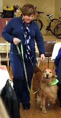 Kelly Dearlove, of Varna, models an outfit from The Wardrobe Bizaar while her companion,  Cannelle,  a bilingual Golden Retriever proudly displays Woof N' Stuff gear.