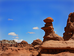Goblin Valley (hkkid98) Tags: park travel blue camping red sky nature rock clouds landscape utah nikon sandstone desert state hiking layers goblins goblinvalley s3000