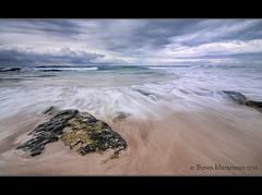 The Missing Sunrise! (danishpm) Tags: ocean seascape storm beach clouds sunrise canon sand rocks wave australia wideangle nsw aussie aus 1020mm manfrotto sigmalens kingscliff eos450d 450d abigfave kingcliff 06ndgrad tweedshire sorenmartensen hitechgradfilters