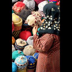 Decisions Decisions (Dave-Mann) Tags: travel market hijab hats morocco maroc marocco marrakech souk marrakesh marruecos marokko marrocos fas travelphotography 18200mm redcity marokk maroko   moroccanwoman    nothafrica   hatstall    nikond300s