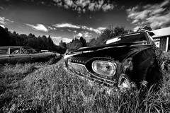 Wide angle Taunus ([AndreasS]) Tags: old sky blackandwhite white black history ford abandoned broken nature cemetery graveyard car canon lost photography eos photo junk rust angle sweden decay grunge wide rusty location stack vehicles forgotten area bil 5d disused veteran scrap derelict heap taunus m2 decayed mii rustne kirkegrd mark2 veteranbil rusten bilvrak forlatt bstns fgelvik bilpark bilkirkegrd bilskroten