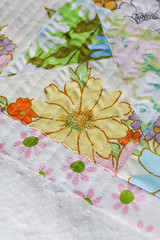 Secret (Jeni Baker | In Color Order) Tags: floral june modern vintage apartment quilt recycled handmade linen sewing sheets fabric quilting stitching sheet block quilts crafting 2010 bedding repurposed bedsheet reused