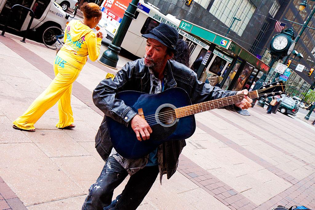 Man-playing-guitar--Center-City