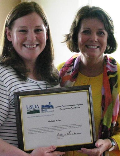 New homeowner Melissa Miller (Left) and Colleen Landkamer, State Director, USDA Rural Development, celebrate Miller's accomplishment.