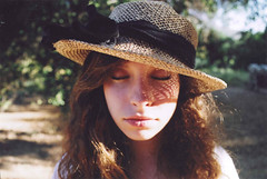 (amnda adam) Tags: light film girl hat canon hair rebel eyes shine feel calm curly breeze eosg