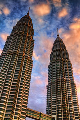 Sun Rising on the Petronas Towers (Jim Boud) Tags: morning travel bridge sky orange building tower clouds skyscraper photoshop sunrise canon silver lens asian eos prime grey hotel shiny colorful asia cloudy metallic gray landmark malaysia