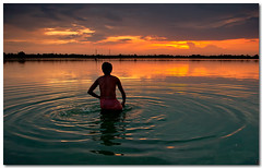 cooling off (Soumya Bandyopadhyay) Tags: sunset summer lake water colors landscape bath afternoon dusk wide ripples gradnd pentaxk200d pentax1855mmii