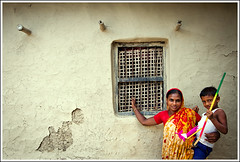 Of soil and unsoiled souls [..Chuadanga, Bangladesh..] (Catch the dream) Tags: house home window smile toy child mud mother grill soil clay cracks flakes bangladesh abode mudhouse clayhouse sharee chuadanga flickrdiamond familygetty2010 gettyimagesbangladeshq2