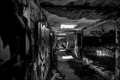 Il est au bout du couloir.../ He is in the corridor... (vedebe) Tags: humain people couloirs abandonné decay urbex urbain ville city rue street noiretblanc netb nb bw monochrome architecture