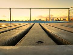 The end of another day (2) (analoca) Tags: wood sunset pordosol summer brazil sky pool brasil landscape grid balcony sony portoalegre paisagem grade piscina céu verão rs madeira terraço hx1