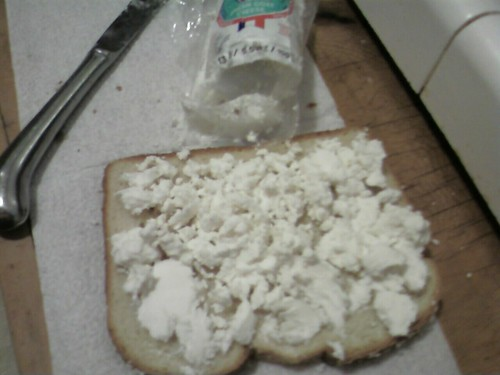 And then spread the second slice with goat cheese