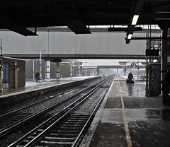 Woman with luggage, Gatwick station - by Julia Manzerova