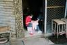 Street pedicure - Danshui, Taiwan (deepstoat) Tags: film zeiss 35mm foot toes taiwan pedicure contaxg2 deepstoat
