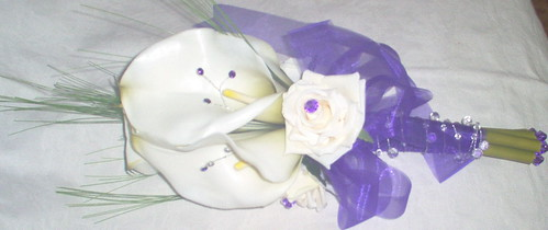 *karen 914c h/t* brides calla lily and rose bouquet/handtied with purple gems and purple ribbon by you.