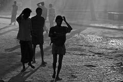 Waking up! (bag_lady) Tags: street men blackwhite shadows earlymorning indians southindia kerla fortkochi 5photosaday bluelist concordians earthasia unseen~india asiablackandwhitephotographs