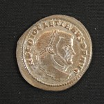 "<b>337 Obverse</b><br/> <a href=""http://en.wikipedia.org/wiki/Diocletian"" rel=""nofollow""><u><b>Diocletian</b></u></a> <i>Reign: AD284 - 305</i> With Diocletian's ascent to power, the ""Crisis of the Third Century"" was at an end. However, Diocletian split the Empire into the Western and Eastern halves, in 286. Historians see this as one of the many moves that led to the collapse of the Western Roman Empire. He made Maximian the Augustus of the West, while Diocletian himself ruled the East. At the dawn of the 4th century, he started the Diolectian Persecution, the last persecution of Christians in the Roman era.  Donated by Dr. Orlando ""Pip"" Qualley<a href=""http://farm5.static.flickr.com/4053/4351358119_f993f16b17_o.jpg"" title=""High res"">∝</a>"