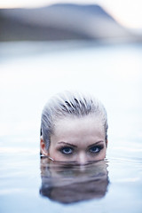 Submerged (LalliSig) Tags: blue portrait woman brown white black reflection wet water hair iceland blurry eyes bokeh gray headshot portraiture gaze
