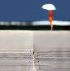 """No Take Off?"" (helmet13) Tags: raw mauritius landingstage maryp sky wave selectivefocus woman umbrella phvalue harmony 100faves world100f peaceaward indianocean platinumpeaceaward heartaward 300faves"