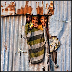 Rewards of life [..Dhaka, Bangladesh..] (Catch the dream) Tags: life family house love window smile look tin women rust child laugh shanty dhaka cloth bangladesh corrugated slum olddhaka dialipidated gettyimagesbangladeshq2