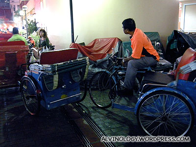 Bored trishaw uncle waiting for the event to start