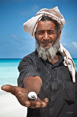 when all you breathe is salty air (sadaiche (Peter Franc)) Tags: old travel man water shirt beard island seaside hand turquoise sandy headscarf salt shell arabic salty yemen hold yemeni socotra arabiafelix suqatra