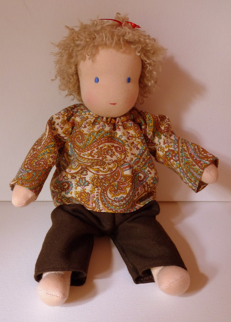 Mia's baby Sally in her paisley smock top and woollen trousers