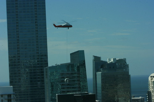 Helicopter delivering A/C equipment
