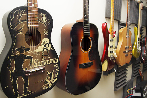February 16, 2010 - A row of guitars and other instruments line the wall at Henry's home in Shutesbury.