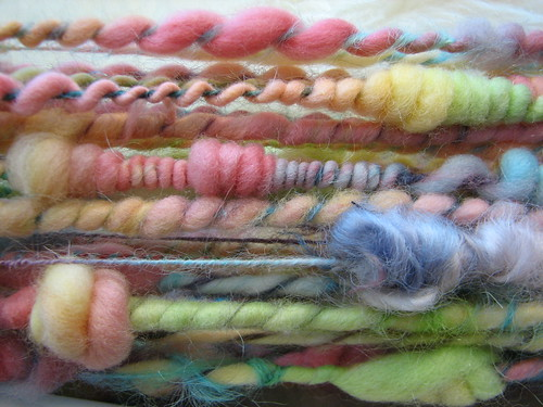 this is the leftover roving spun into 3 different things on one mohair yarn base