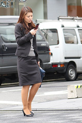 business woman (mrlenours) Tags: woman girl rain japan hair japanese grey gris portable highheels phone working longhair cellphone cell pluie skirt  heels  heel jupe fille japon  tlphone    japonaise kyto tlphoneportable escarpin  himashiyama