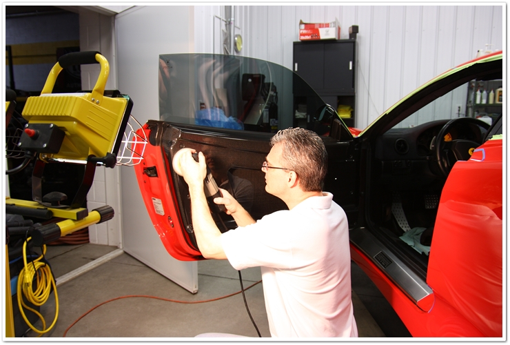 Polishing carbon fiber door panels