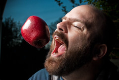 116/365 - adam (Micah Taylor) Tags: sunset red portrait apple self mouth teeth bite midair temptation project365