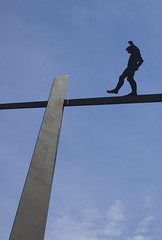 Tightrope walker, sculpture, Berlin, 2008. Photo from beezerella at flickr.com. Used by permission.
