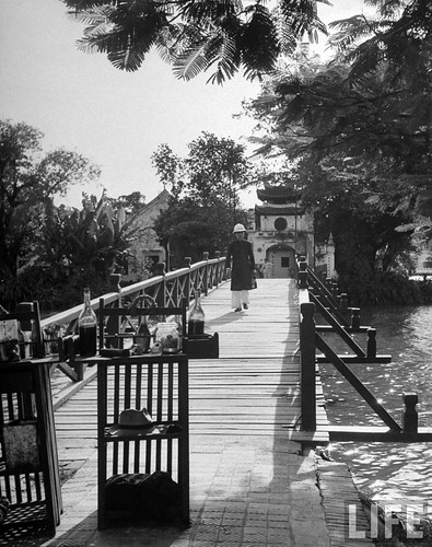 Hanoi 1948 - Man walking over an arched bridge, in French Indochina