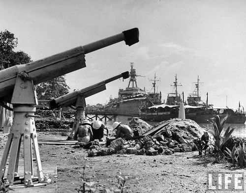 Saigon 1948 - Native laborers working cementing gun emplacements, in French Indo China.
