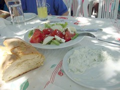 greek salad meal with tzatziki and bread