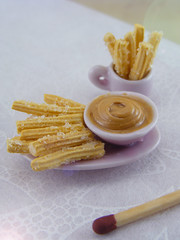 Churros with Caramel (dulce de leche) (Shay Aaron) Tags: party food house scale southamerica kitchen argentina feast dessert cuisine miniature buenosaires doll dish handmade traditional aaron culture fake mini fimo caramel clay tiny faux shay gnocchi 12th 112 churros dollhouse petit dulcedeleche empanadas alfajores delights twelfth polymer churos foodaroundtheworld oqui shayaaron
