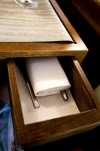Secret table drawer for flatware and napkins