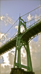 towering over (Jim JP Hansen) Tags: usa green clouds oregon portland arches bluesky structure lookup pointandshoot willametteriver towering gothicarchitecture stjohnsbridge jphansen