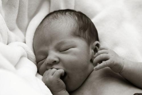 baby gavin hand mouth portrait b&w