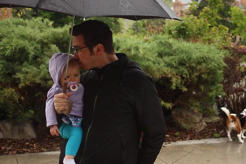 Smooching under an  umbrella