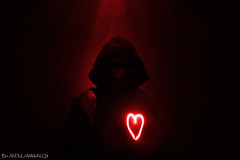 No Matter How Evil People are, They Have A Heart (Fahad Al-Thekair) Tags: camera red portrait people mystery canon dark exposure slow heart evil mysterious kuwait 1855mm society q8   400d  rebelxti   boabdulrahmanq8