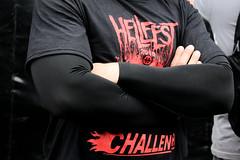 Big muscles under a dark t-shirt