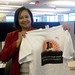 Claire Wilson, Marketing Manager shows off her new t-shirt celebrating XO's industry milestone and achievement of reaching one million VoIP business end users.