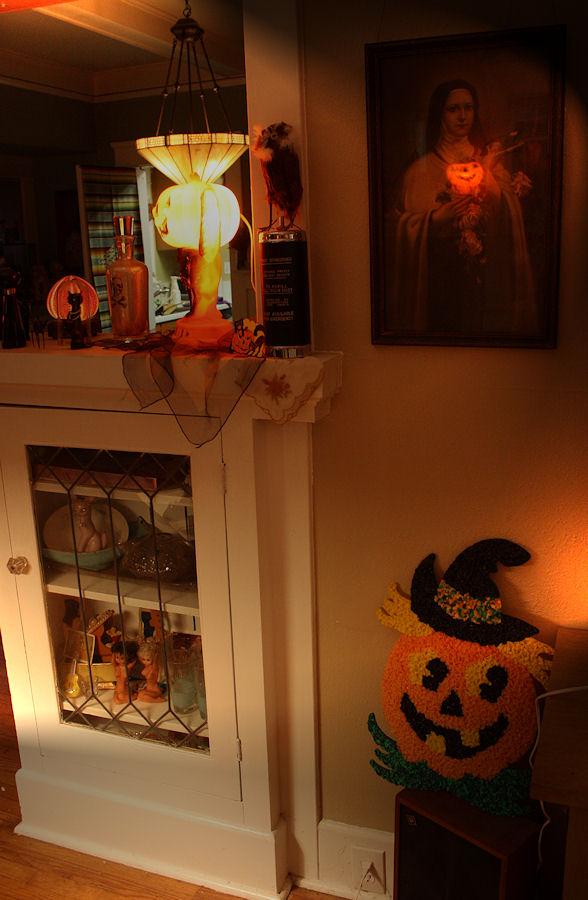 Saint holding a pumpkin.