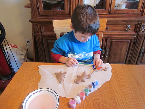 Child painting an ornament